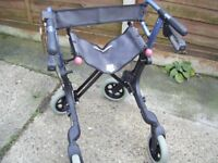 Top of the range mobility walker with breaks and bag ect.