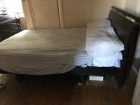Solid dark wood Small double bed
