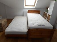 Single bed with underneath trundle bed. Can be used as two single beds or a double. Great spacesaver