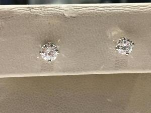 #156 14K WHITE GOLD SCREWBACK EARRINGS TOTALING .60CT IN DIAMONDS. APPRAISED AT $3250.00 SELLING FOR $1095.00!