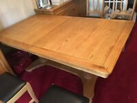 Furniture village solid oak 6/8 seater table and four chairs