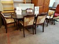 Large extendable brown dining table and 6 fabric chairs