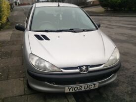 Silver Peugeot 206 Lx, brand new battery, low price due to work needing done, Dunmurry / Belfast