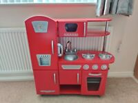 Red wooden kidkraft play kitchen and accessories