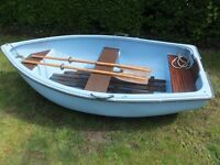 Fibreglass dinghy for sale, recently repainted and ready to use with oars and rowlocks.