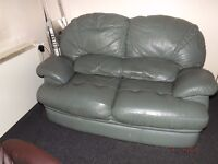 Real leather two seater sofa.