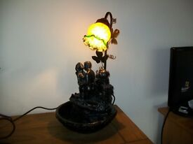 electric table lamp with water feature in bronze