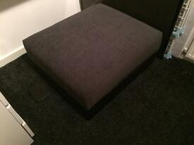 Grey and black leather footstool