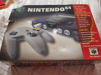Nintendo 64 Console with 4 Games, 1 Shock Memory Pack, 1 Memory Pack & Official Green Controller