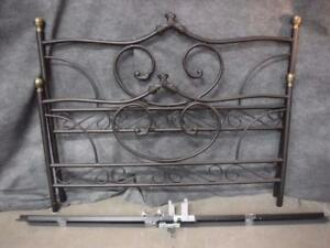 Metal bed frame with intricate head board and foot