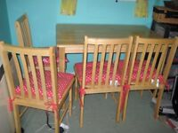 Pine Effect table & four chairs with new seat cushions. £45 Length 104cm, W 69.5cm , Height 71.5cm
