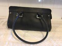 A very smart leather look black handbag