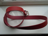 52 inch (not including buckle) RED LEATHER BELT with SILVER BUCKLE. CAN EASILY BE SHORTENED