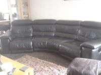 Black leather curved reclining sofa with adjustable head rests Ex Sterling