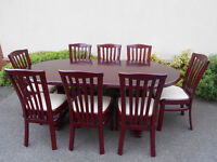 Lovely dining table with 8 chairs. Can deliver