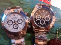 two swiss rolex daytona white face blck face collection