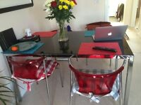 Stunning Ikea Torsby Black Glass Table & modern Elmer Red Chairs