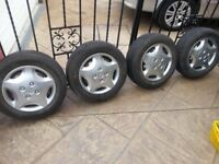 ford steel wheels & trims 4 stud fitment with 4 matching 185 65 14 continental tyres bargain £30