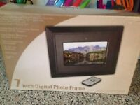 7inch Digital Photo Frame. Never used and in original packaging. Would make a great gift.