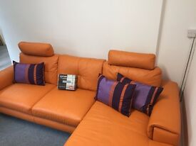 Corner sofa and matching swivel chair and footstall with leather care kit