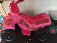 Girls ride on electric quad