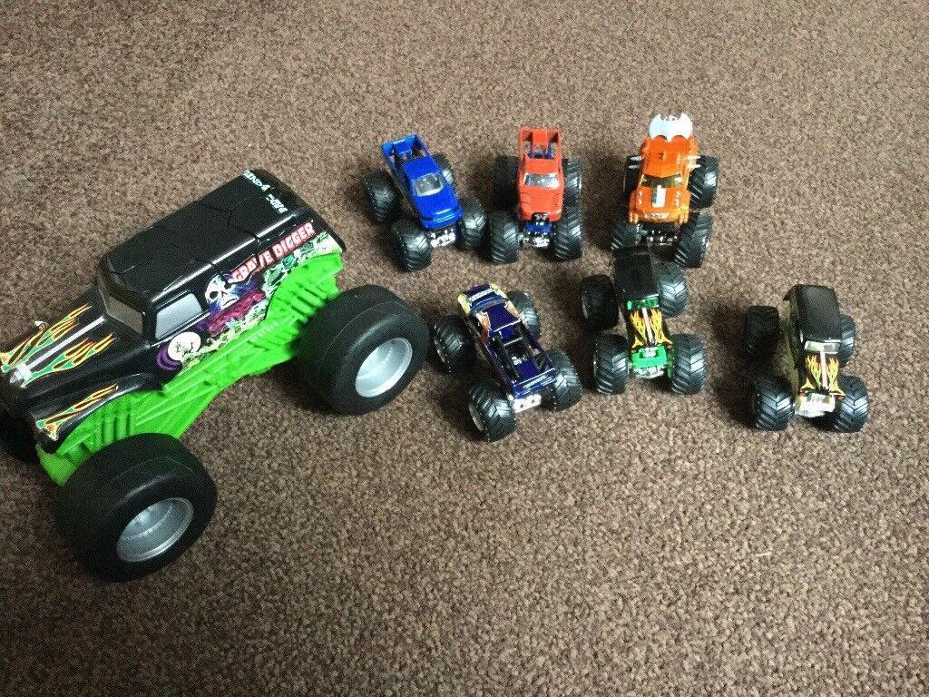 Large monster truck with smaller monster trucks