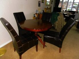 Mahogany coloured circular extending dinning table with 4 chairs £80:00 or near offer 07870888360