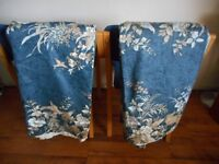 Large pair of lined blue pattern curtains.