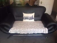 2 x Matching 2 Seater Modern Faux Leather Sofas