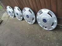 set of 4 ford transit wheel trims well used ford van trims scratches etc