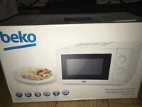 Brand new Beko microwave in white