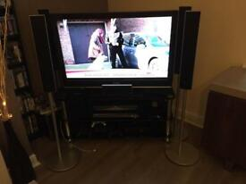 "40"" Sony Bravia TV with separate DVD and surround speakers and glass TV stand"