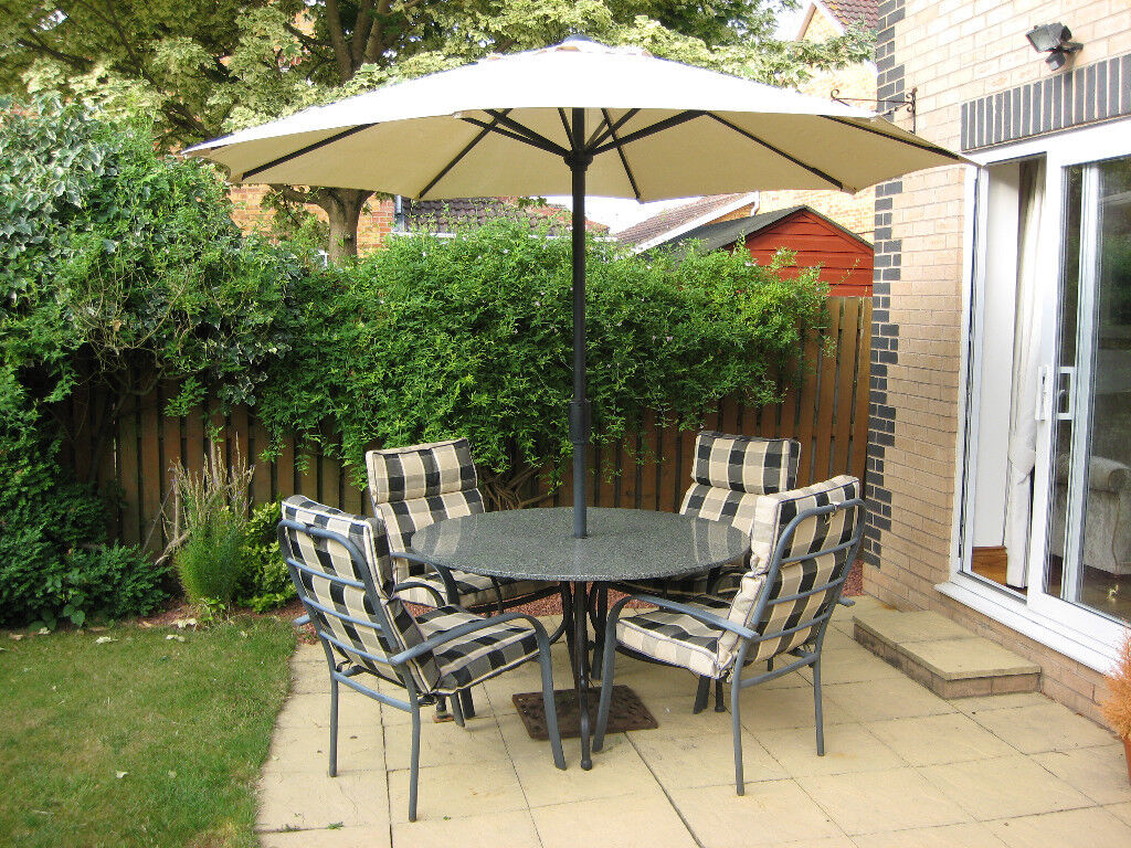 Garden table 4 chairs and umberella york