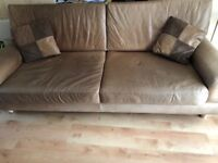 Tan / Brown leather sofa with pillows