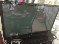 LG 37 inch flat screen television, with dvd player and tv stand