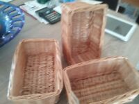 Small open rectangular whicker baskets.