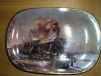 A collectable limited edition Flying Scotsman small decoration plate by the artist Terence Cuneo.
