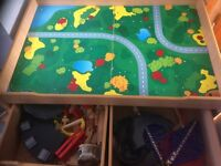 Wooden Train track play table approx 4ft x 3ft. 2 storage drawers underneath. Thomas Tank