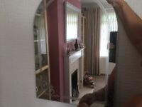 2 arched mirrors