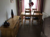 Dining table and 4 chairs and matching sideboard.