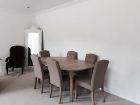 Beautiful Neptune Sheldrake table in pale oak, extends to seat 10 people. New