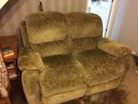 Two piece reclining sofa ( three seater) and a two seater)