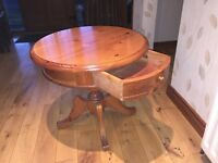 Circular pinewood pedestal coffee table with drawer