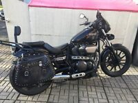 Yamaha XVS950 black and chrome motorbike
