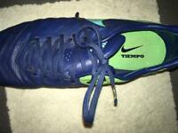 Green tiempo football boots