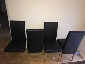 Black leather dining room chairs. Set of 4, great condition ..