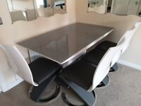 Glass Top Dining Table and 4 Leather Seated Chairs in grey and white