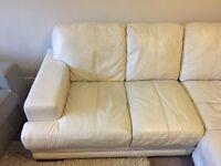 Cream leather corner sofa and storage footstool free to good home. Collection only
