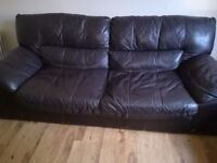 Free to uplift two leather couches
