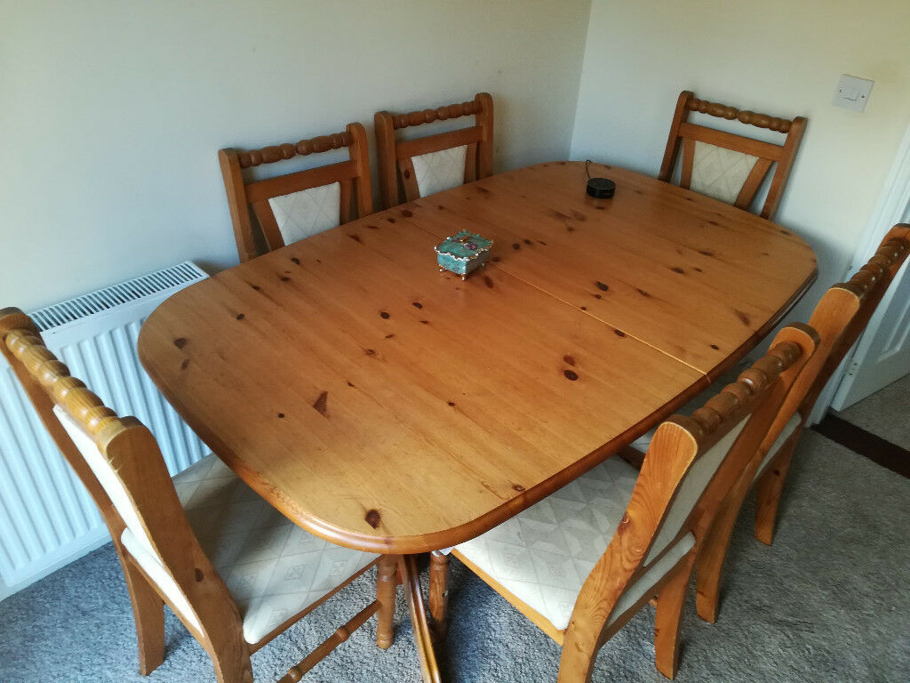 Used Solid Wood Dining Room Table With 6 Matched Chairs